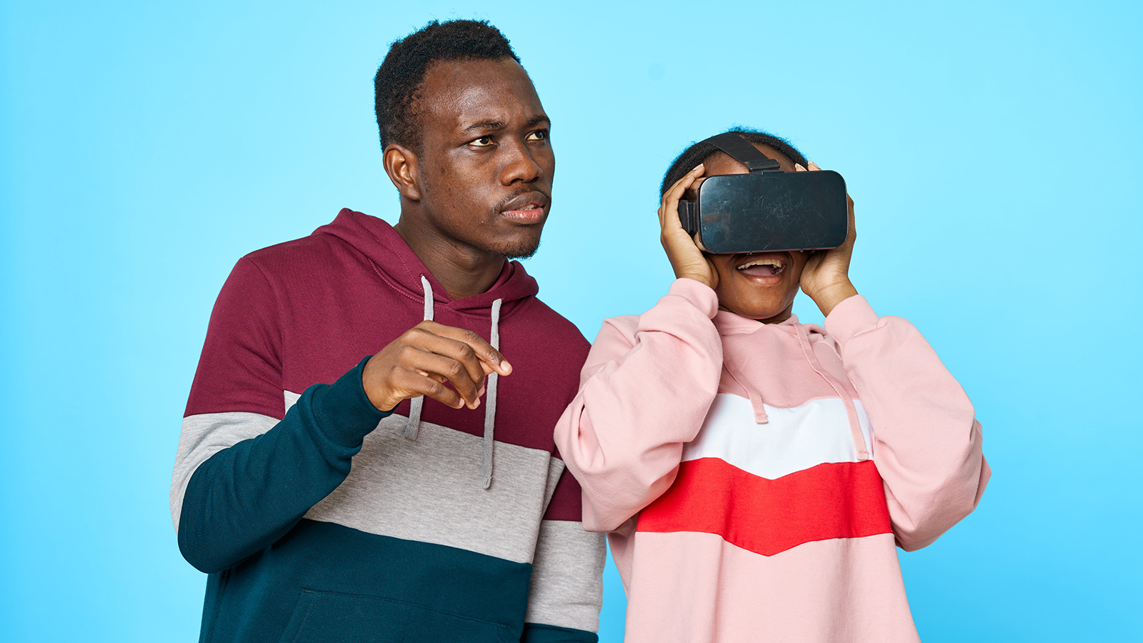 Child wearing VR headset with Father watching