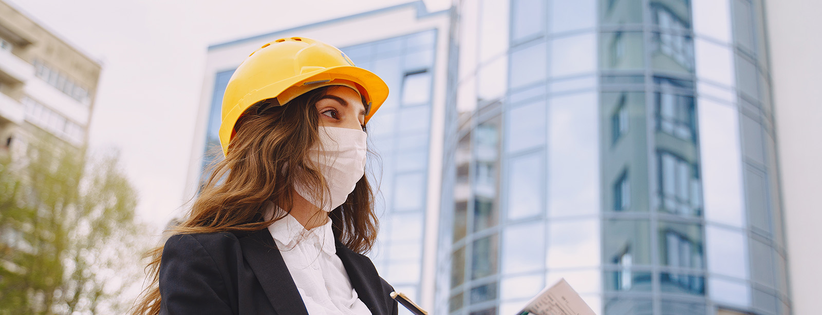 Female architect with construction site on the background