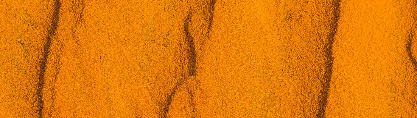 Sand with waves in the red desert.